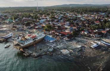 A ship is seen stranded on the shore after an earthquake and tsunami hit the area in Wani, Donggala, Central Sulawesi, Indonesia October 1, 2018 in this photo taken by Antara Foto.  Antara Foto/Muhammad Adimaja/ via REUTERS  ATTENTION EDITORS - THIS IMAGE WAS PROVIDED BY A THIRD PARTY. MANDATORY CREDIT. INDONESIA OUT. NO COMMERCIAL OR EDITORIAL SALES IN INDONESIA. - RC12E9972E90